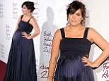 How to dress when heavily pregnant: Lily Cooper shows off her huge bump in midnight blue gown at British Fashion Awards