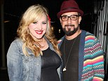 Ready to pop: A.J. McLean and wife Rochelle pictured last week before Rochelle gave birth to baby Ava