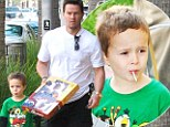 Christmas has come early! Mark Wahlberg treats his mini-me son to toys and a lollipop as duo go shopping together