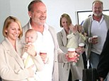 Kelsey Grammer puts on brave face as he arrives at LAX with Kayte and baby Faith... as it's revealed he plans to move into home he shared with ex to 'save cash'