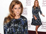 Still keeping those pounds at bay: Princess Beatrice shows off her slim figure in a stunning blue and silver dress