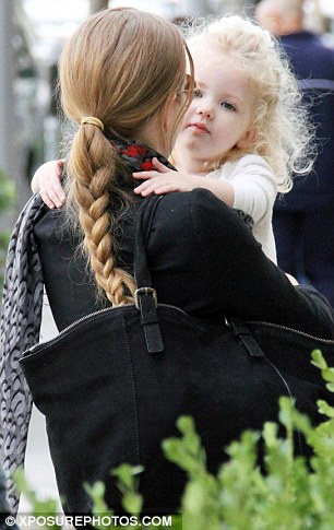 Affectionate: The curly-haired youngster treated her mummy to a tender hug