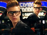 Specs appeal! Justin Bieber ditches the hip hop look in favour of nerdy glasses, quiff and leather jacket