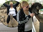 'I got a new pony!' Rebel Wilson cuddles up to kangaroos and koalas as she enjoys time in her native Down Under