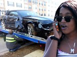 Totalled: Bobbi Kristina's black Chevrolet Camaro is towed out of an embankment after her crash in Alpharetta, Georgia on Wednesday