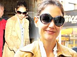 The smile that says Suri is back in town! Katie Holmes looks gleeful on the way to rehearsals after reunion with daughter
