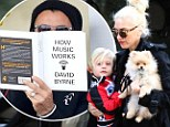 Shouldn't you know that by now? Gavin Rossdale reads up on 'How Music Works' as Gwen Stefani takes little Zuma for a walk in the park