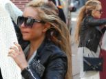 Troubled Amanda Bynes looks like she's just rolled out of bed as she emerges in New York with scraggly hair