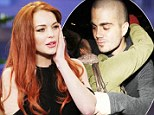 Don't look now Lindsay! Unrepentant Max from The Wanted wraps his arms round more girls after nightclub bust up