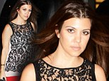 Kourtney Kardashian, wearing a black and white lace top and red pants, arrives at Dash in Miami