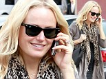 Peek a bump: Five months pregnant Malin Akerman reveals a hint of her changing shape in chic maternity ensemble