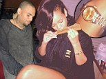 His 'n' hers? Rihanna rolls up and splashes out on new Rolex watch to celebrate topping US chart...as Chris Brown buys the male version