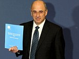 Arrival: Lord Justice Leveson holds his highly-anticipated Inquiry report before its contents are revealed