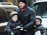 He must have good balance! Liev Schreiber takes BOTH his sons for a ride on his bike