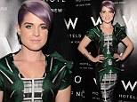It's an urban jungle! Kelly Osbourne shows off her slimline figure in a daring structural print dress