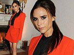 The future's bright for Victoria Beckham as she switches things up in a stylish orange skirt suit for Valentino fashion talk