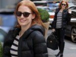 Talk about a sunny disposition! Jessica Chastain gives warm welcome despite covering up from the cold