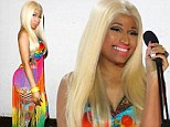 Those hips don't lie! Nicki Minaj shows her feminine curves in bizarre rainbow coloured outfit as she presents ARIA awards