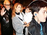 Bundled up: Celine Dion nuzzles her son Eddy in blanket coat as the family leaves Paris hotel