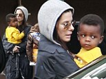 Her golden boy! Sandra Bullock's son Louis is a ray of sunshine on a drizzly day in Los Angeles