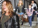 Ode to grunge: LeAnn Rimes wears sexy hipster outfit to fly to Seattle with family