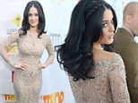 It's Katy Perry night! Singer goes nude in sequined gown as she is honoured for charity work