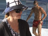 Madonna, 54, covers up while 22-year-old toyboy Brahim Zaibat shows off his six-pack... as they enjoy family time by the pool