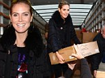 Sleep is for wimps! Heidi Klum shakes off late night partying to help Sandy relief effort in New York