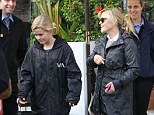 Like mother, like daughter: Ava Witherspoon channels mum Reese¿s style as pair step out in matching raincoats
