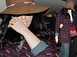 Not so wide awake: Katy Perry refuses to crack a smile as she lands in Los Angeles