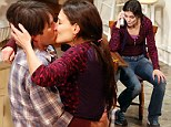 If only she'd been able to kiss Tom this convincingly! Katie Holmes ramps up the passion with Cruise lookalike on Broadway