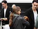 Colin Farrell pets a puppy and grabs a sandwich on the set of Winter's Tale filming at Cooper Union in New York City