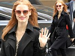 Such a contrast! Jessica Chastain's bright mood does not match her black outfit on New York outing