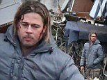A bloody Brad Pitt stands amid plane crash wreckage... but don't worry, it's only a scene for his new film World War Z