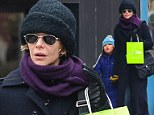 All bundled up: A snug looking Meg Ryan takes daughter Daisy out for a hair cut in New York