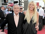 It's back on: Apparently Crystal Harris has realised she can't live without Hugh Hefner and their cancelled wedding is back on for New Year's Eve