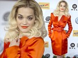 Rita Ora stood out in a silky orange coat which made it appear as if she was naked underneath in Germany on Friday