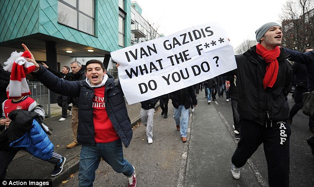 Protest movement: Hundreds of Arsenal fans marched to the Emirates before the match with Swansea City in protest at the club's ownership and high ticket prices