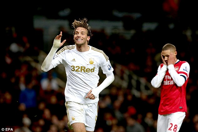Double blast: Swansea's Michu netted twice to settle this match 2-0 in their favour after Arsenal again failed to perform