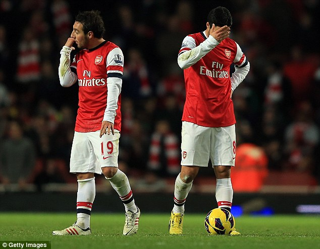 Oh dear: Santi Cazorla (left) and Mikel Arteta look defeated after the defeat left them in 10th in the Premier League
