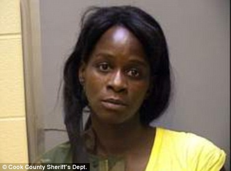Charged: Pamela Davis, 39, allegedly held her hand over her granddaughter's mouth to stifle her cries as she hid with the baby's mother from police