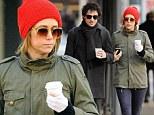 The simple things in life: Kristen Wiig enjoys a stroll in the Big Apple with her rocker boyfriend Fabrizio Moretti