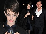 Anne Hathaway is back to her glamorous self as she steps out in London in a little black dress