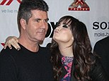 Simon Cowell refuses to confirm if Demi Lovato will return to X Factor USA next season as he brands her 'bitchy and mean'