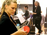Molly Sims enjoys some festive shopping with new baby Brooks as she gears up for son's first Christmas