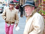 The 71-year-old almost achieved the impossible takes of looking good in a pink pair of trousers as he sauntered down the street during an outing to the well-heeled area.