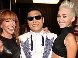 Anti-American? Psy (center) appears with comedian Kathy Griffin (left) and singer Miley Cyrus at the 2012 iHeartRadio Music Festiva