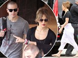 Unflattering: Jennifer Lopez prepares to board her private jet on the Australian leg of her Dance Again world tour on Friday
