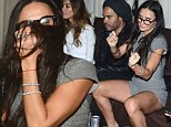 What's eating Demi? Ms Moore's VERY bizarre behaviour as she parties with Lenny Kravitz