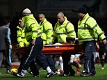 Stretchered off: Diame is taken from the field for treatment